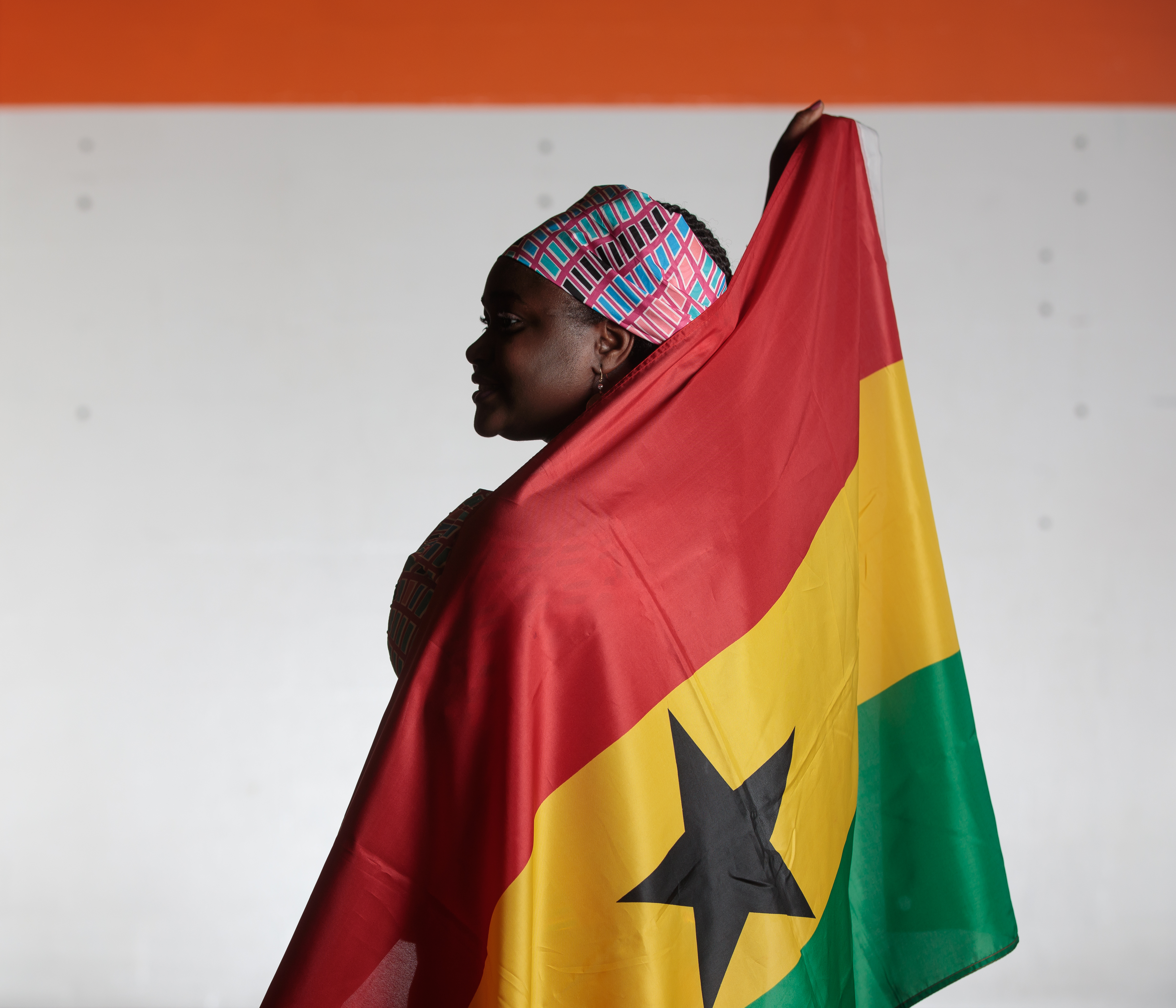 Amara Egbujor holds the flag of Ghana.