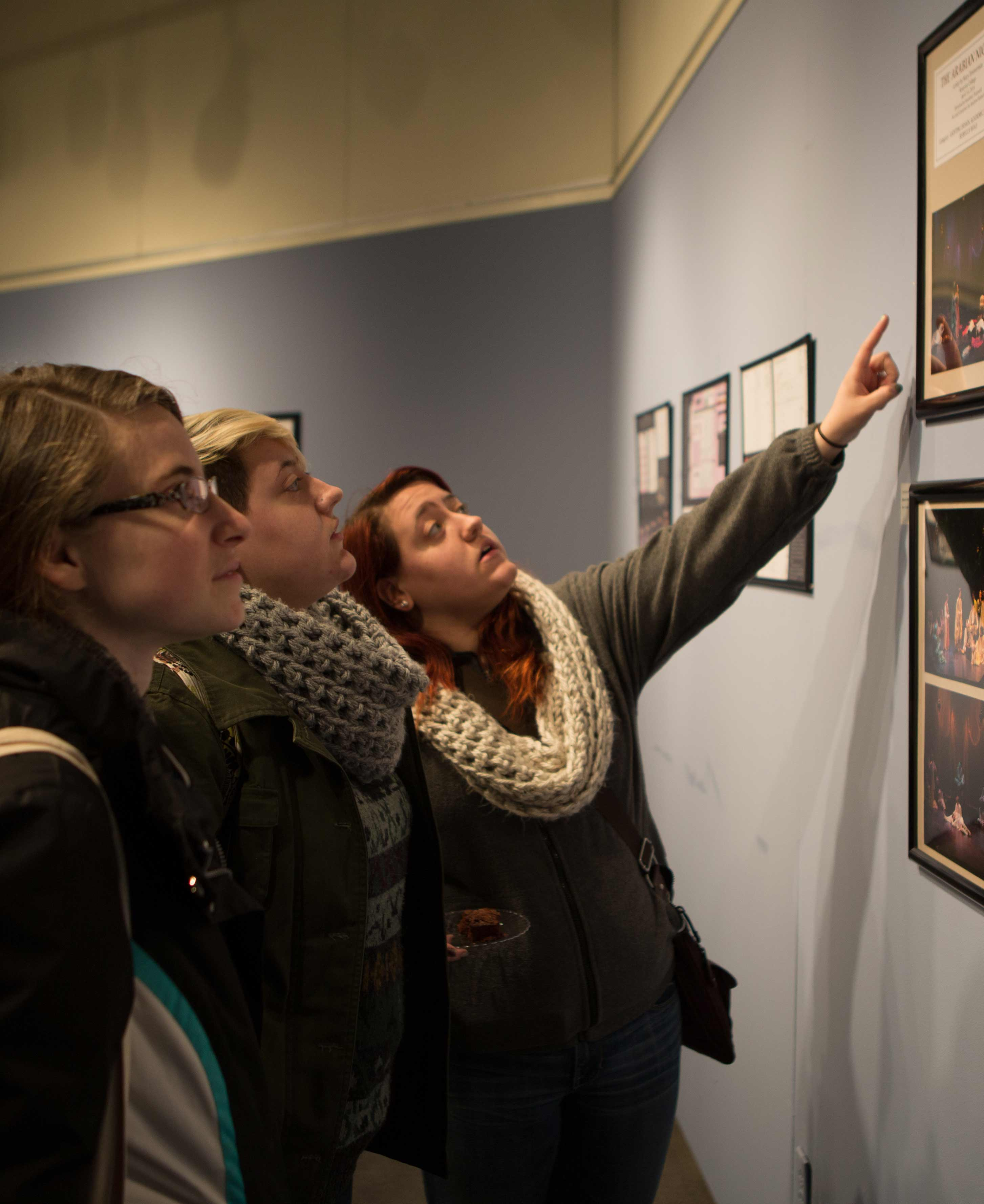 Juniors Veronica Hrovat, Jennifer Giangola and Nicole Giangola, right, looks at the exhibit.