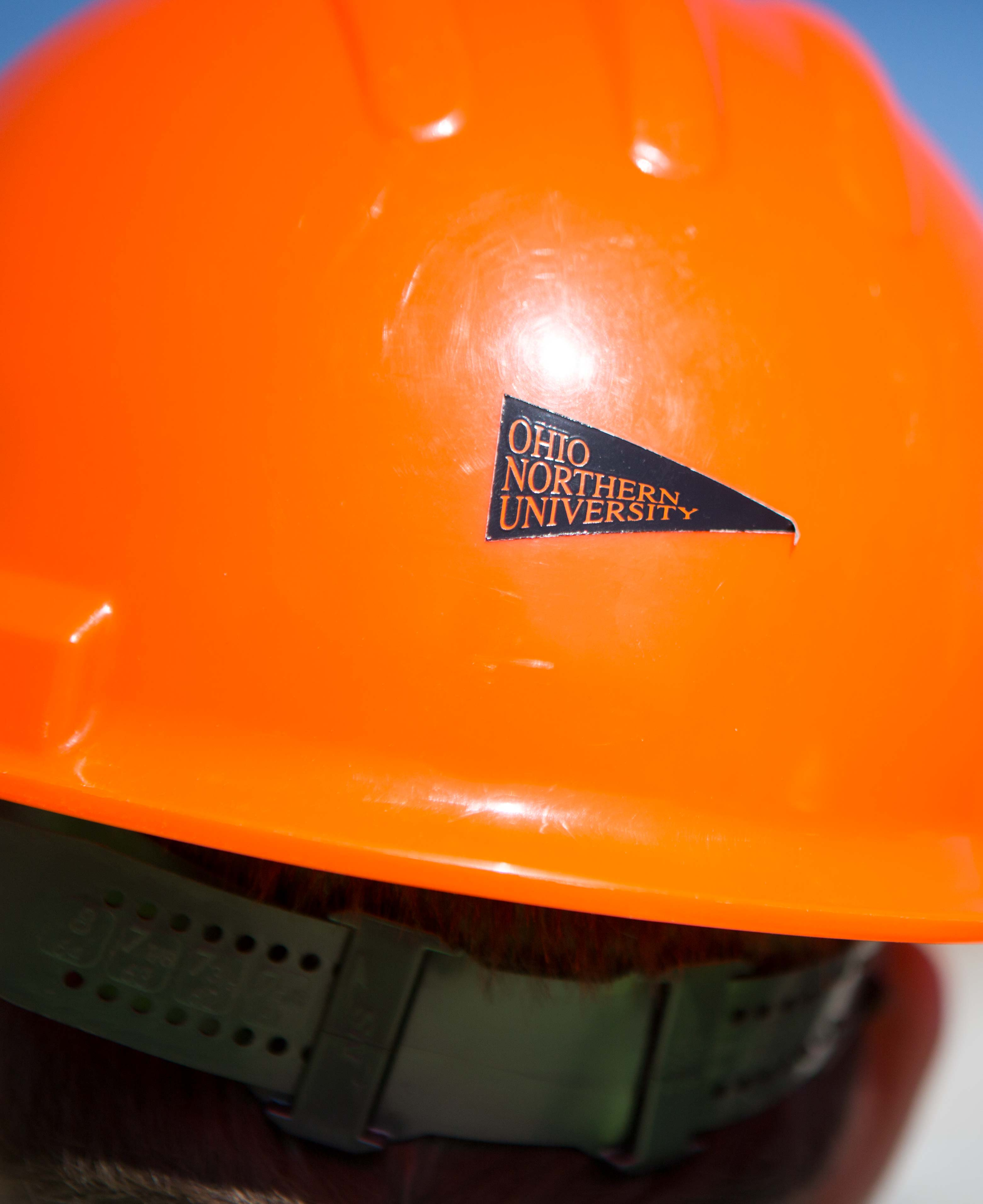 Construction management student in an ONU construction hat