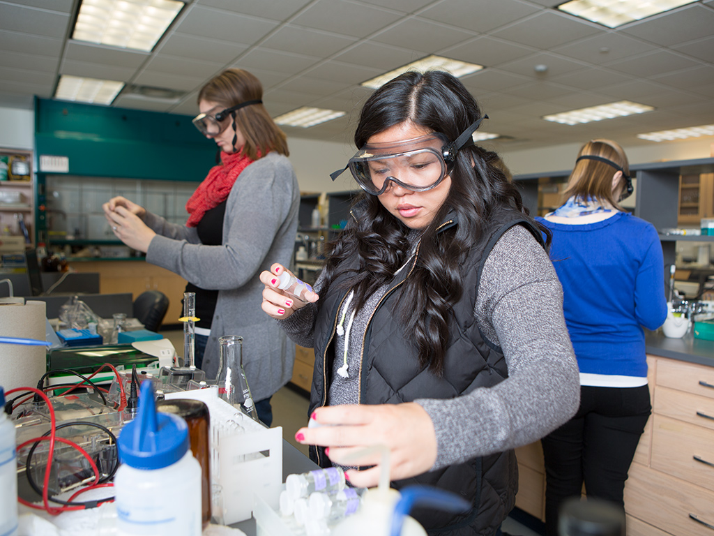 Student working in chemistry lab with equipment