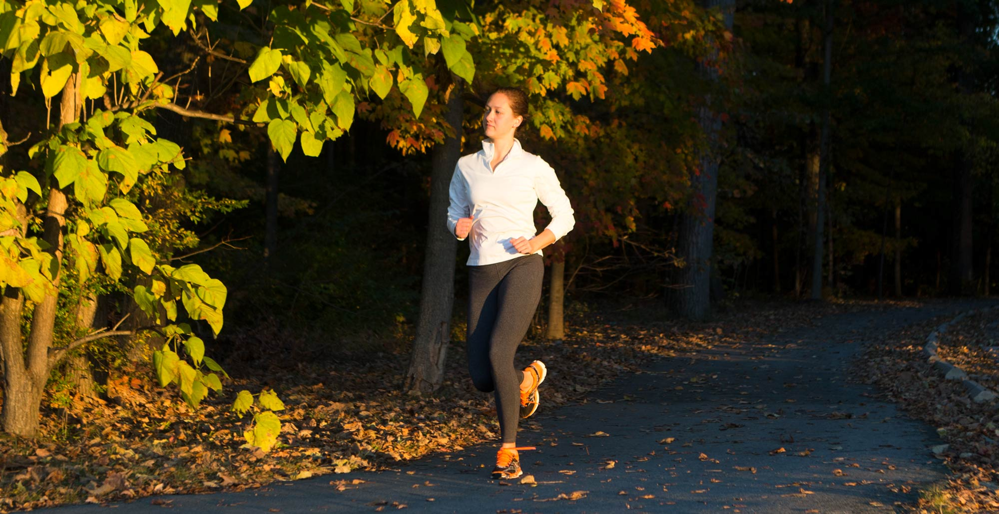 A jogger uses the Green Monster under the changing fall leaves.