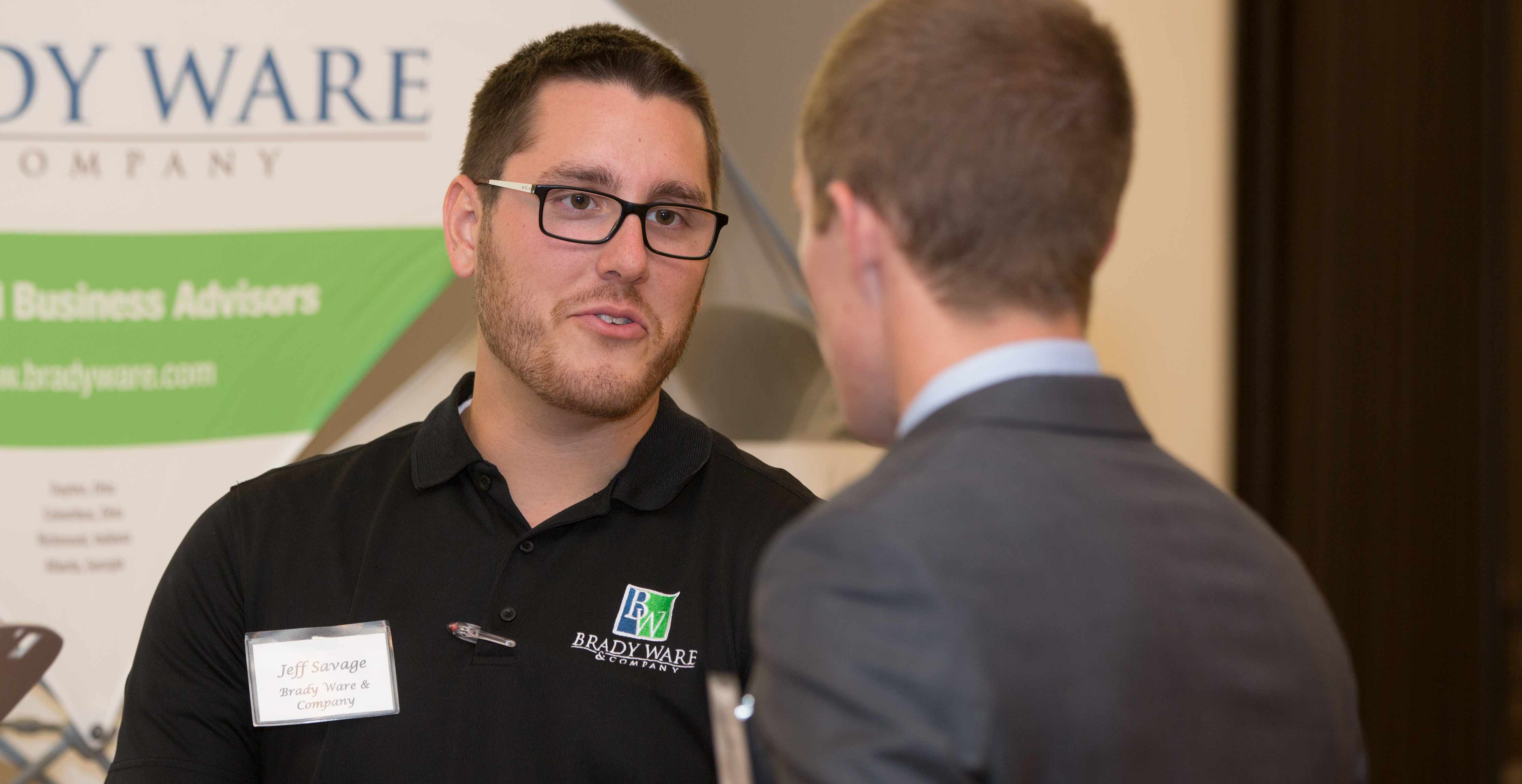 finance student talks to employers
