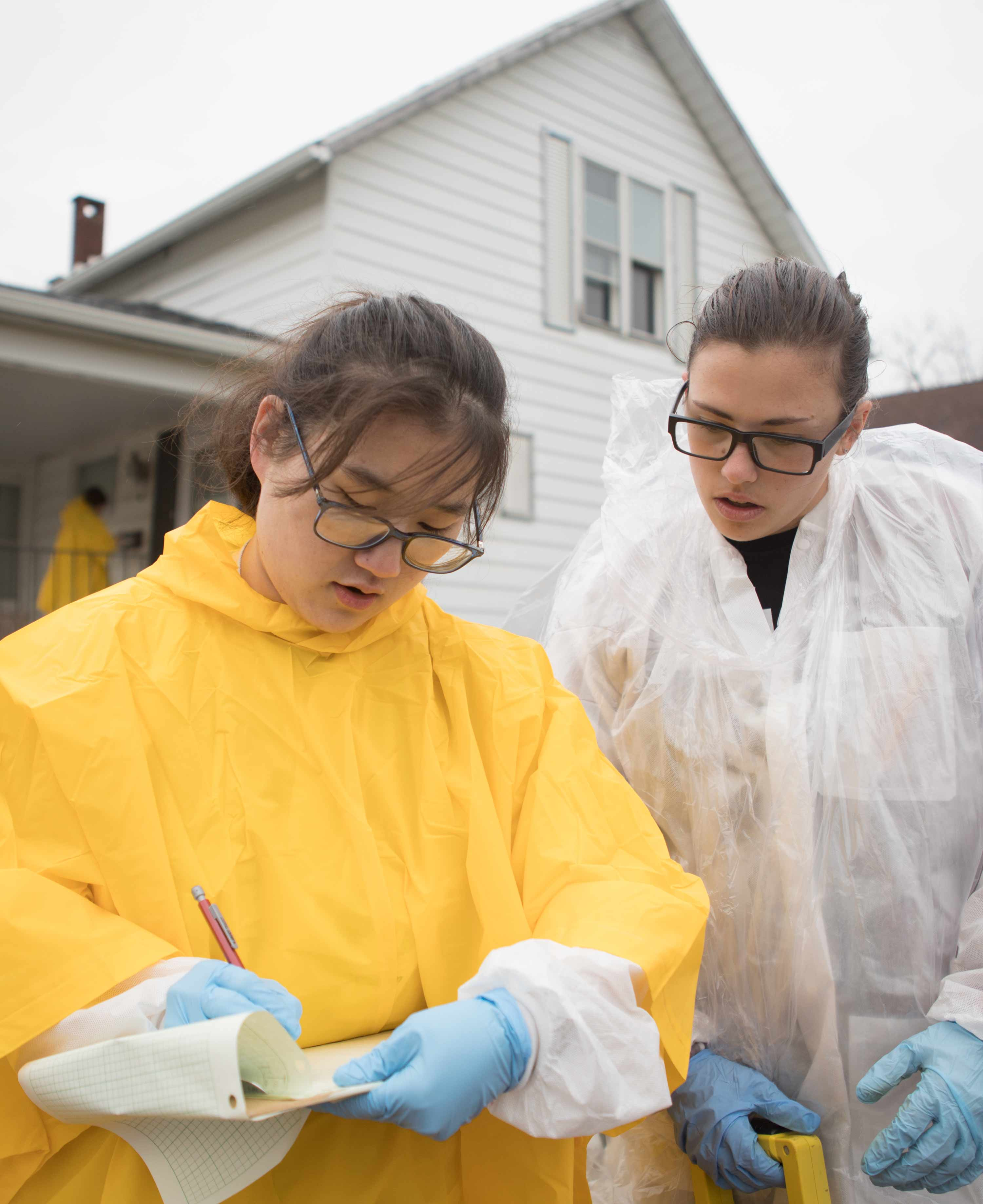 forensic biology students at crime house