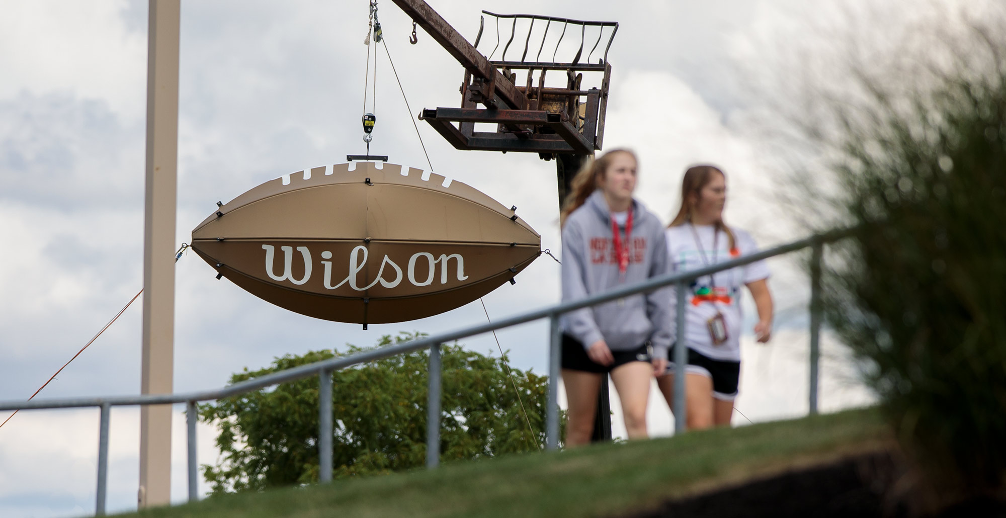 Students walk past the giant Wilson football outside of Dial-Roberson Stadium on the campus of Ohio Northern University.