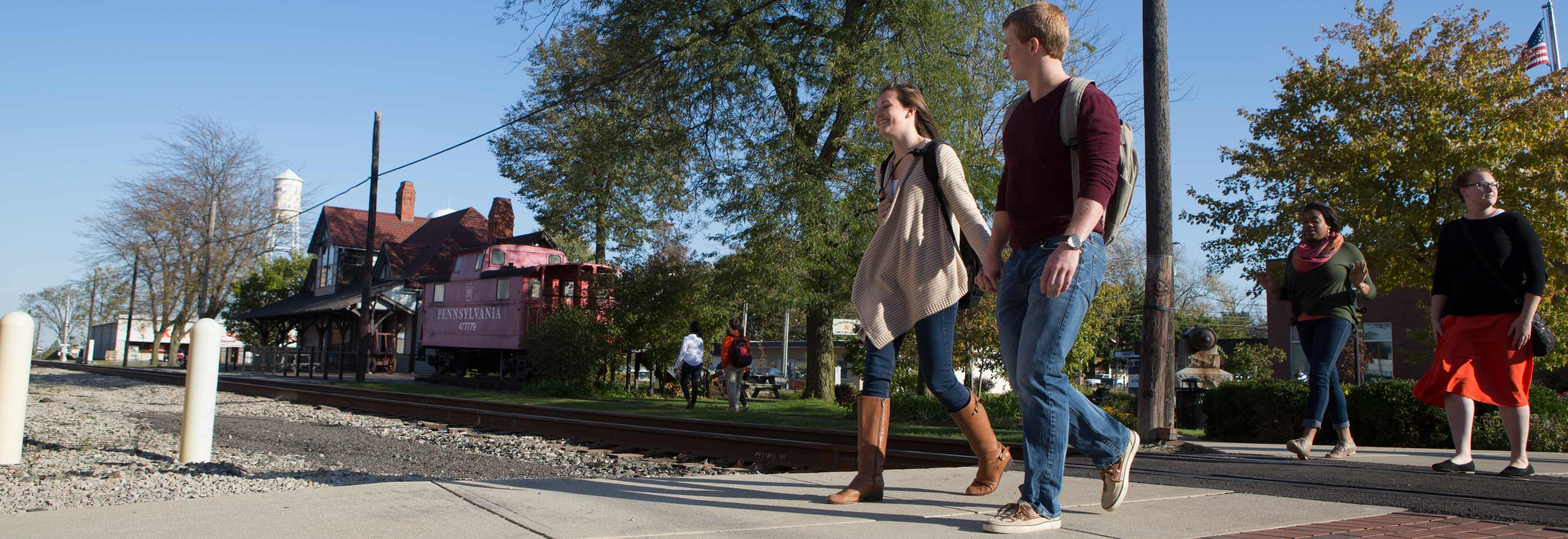 Ohio Northern University students walk through downtown Ada.
