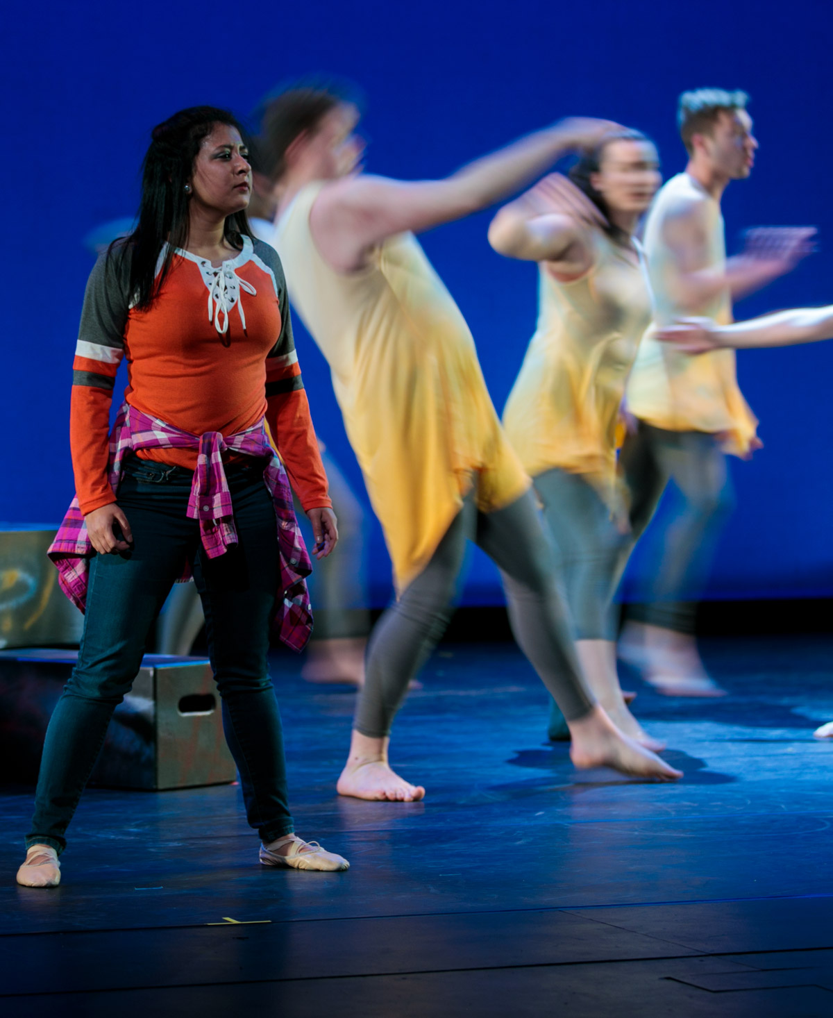 "Students perform with dancers on stage during a rehearsal for ""Choreographers' Showcase"""