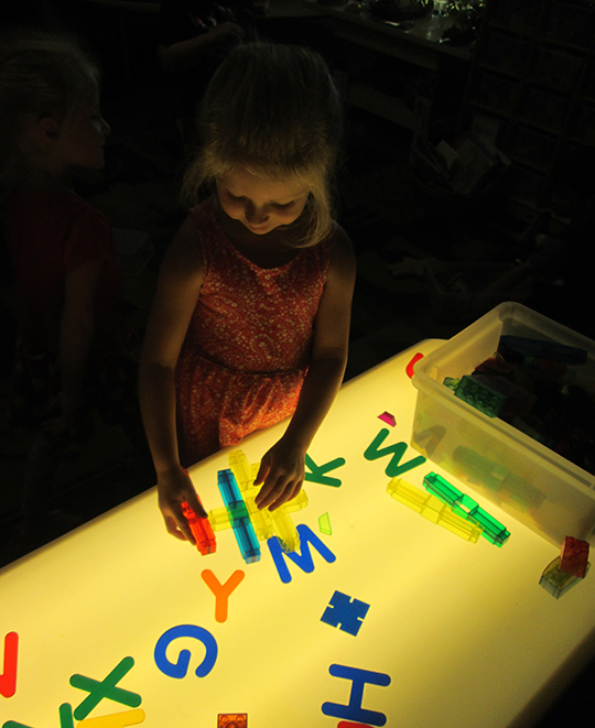 Child playing with letter magnets