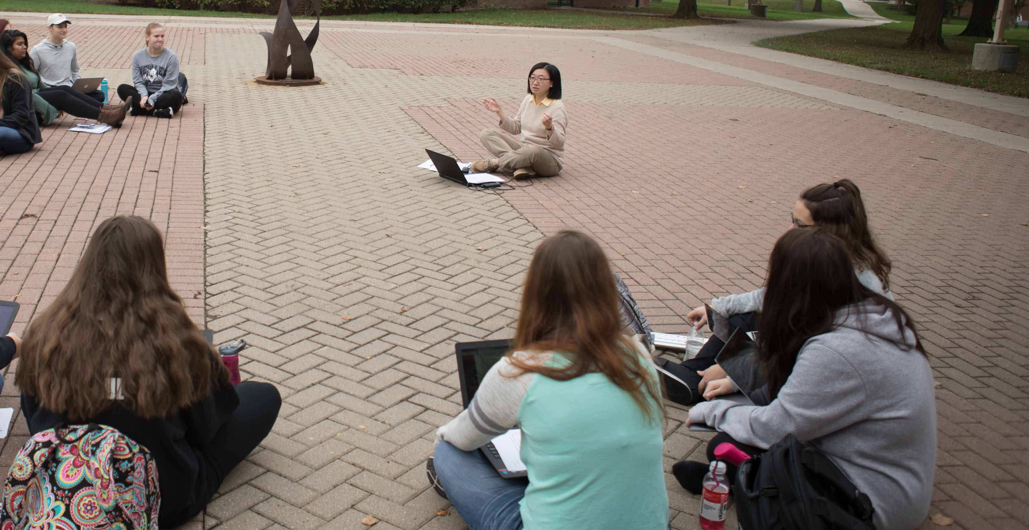 Humanities class outside of heterick memorial library