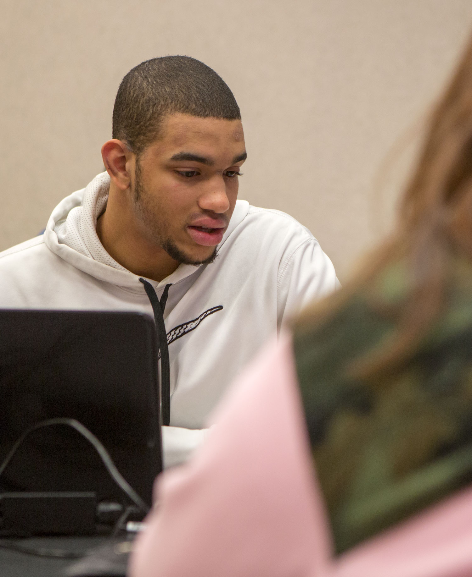 student helps complete the taxes of visitors to the Ohio Northern University Dicke College of Business Administration.