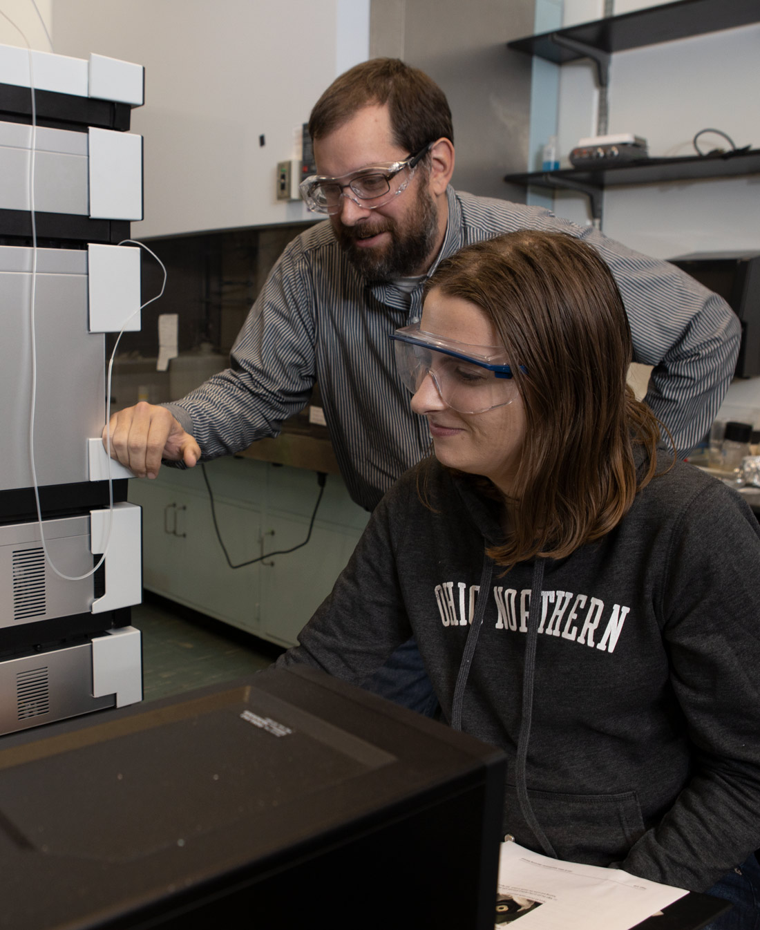 Christopher Spiese associate professor of chemistry works with chemistry students at Ohio Northern University.