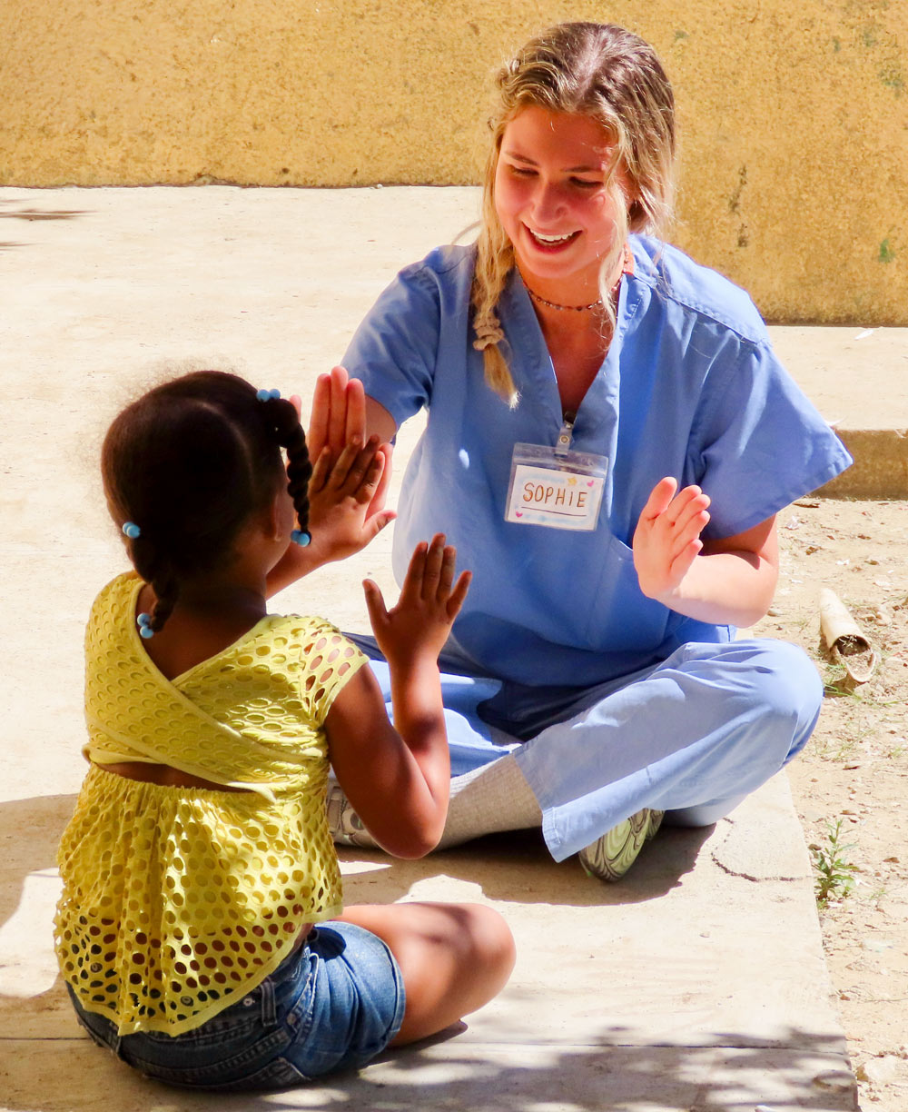 Public health student mentoring a child in the Dominican Republic.