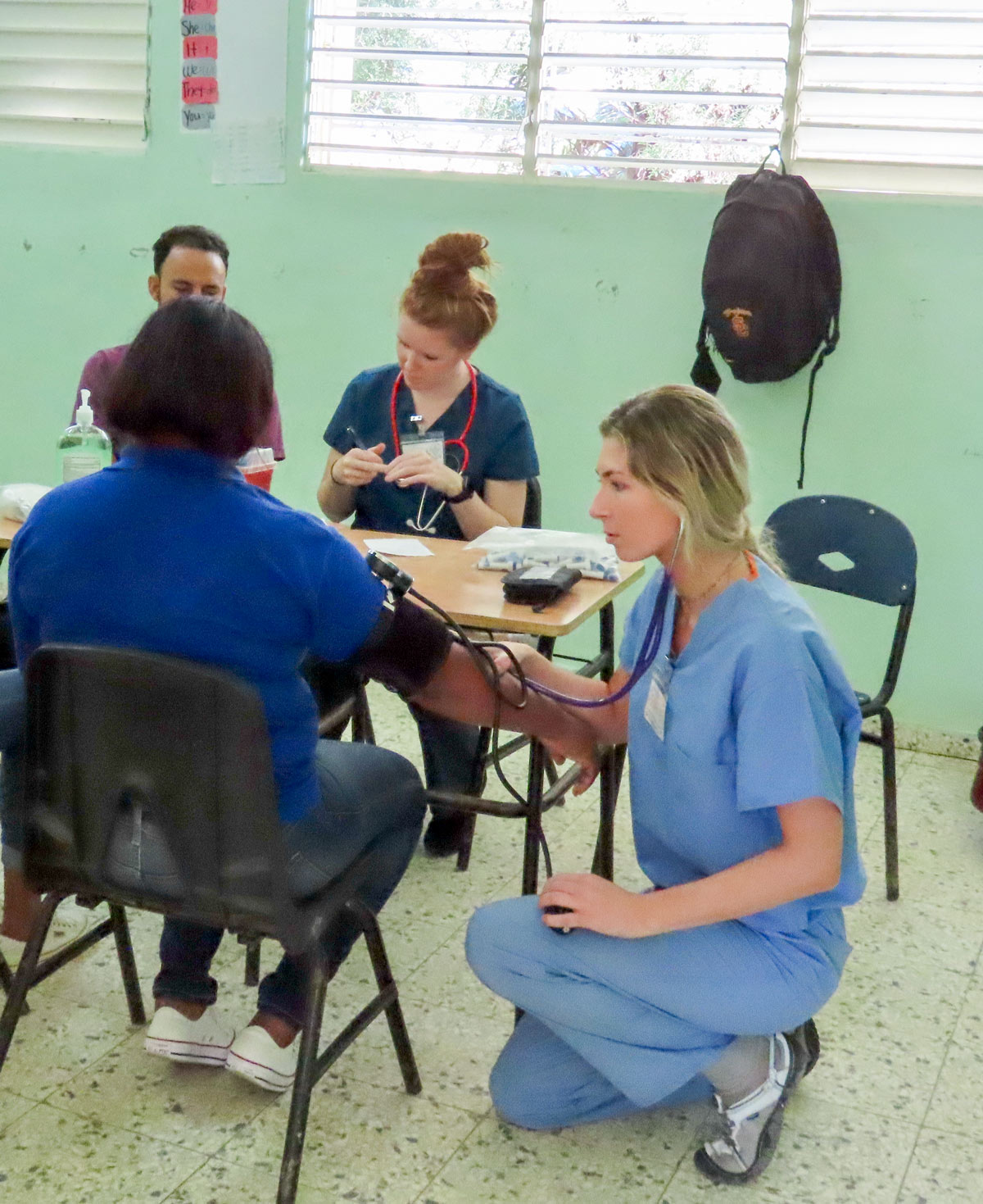 public health student providing health screening in the Dominican Republic