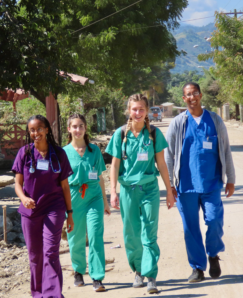 public health students walking down the street in the Dominican.