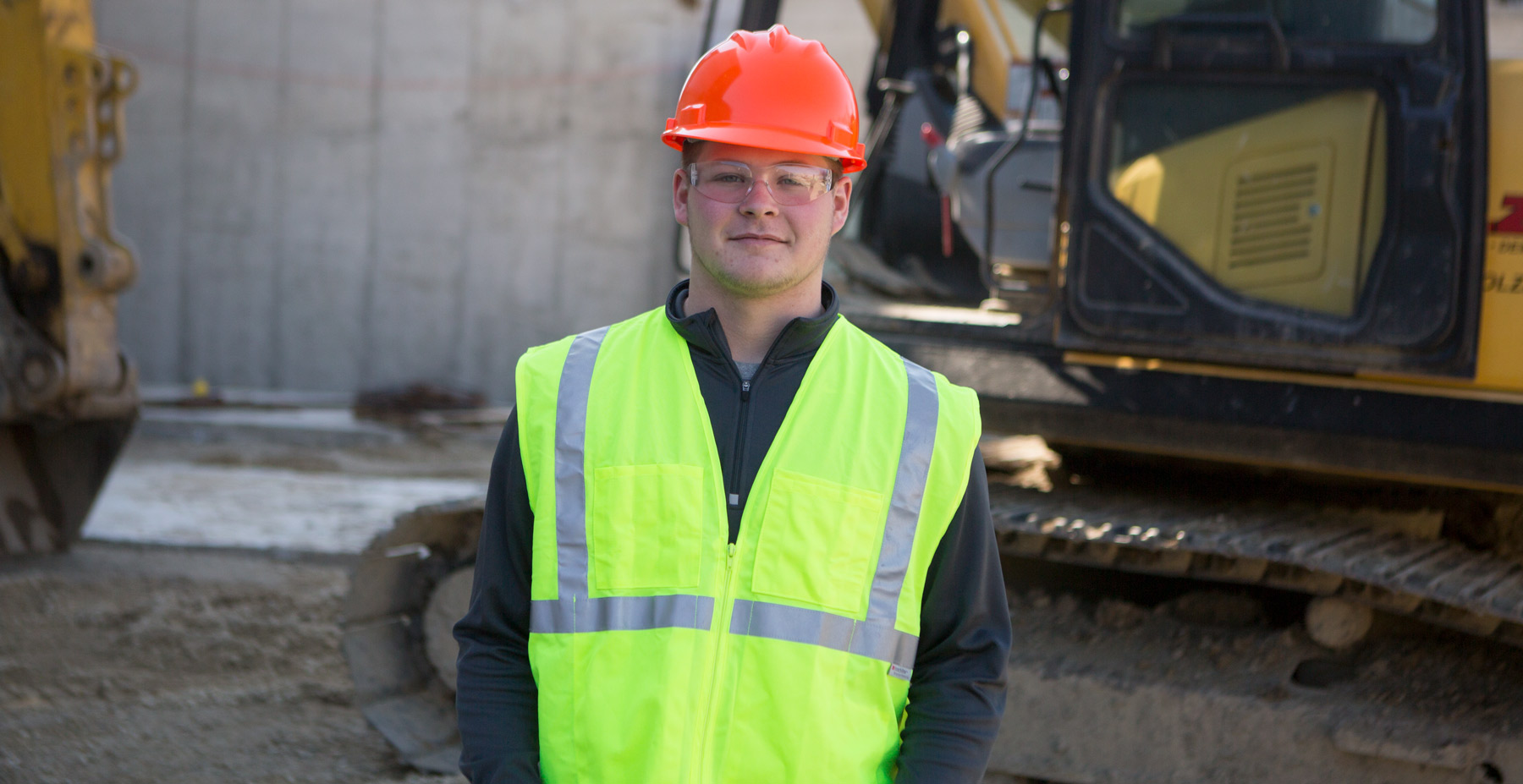 Student is photographed on a construction site.