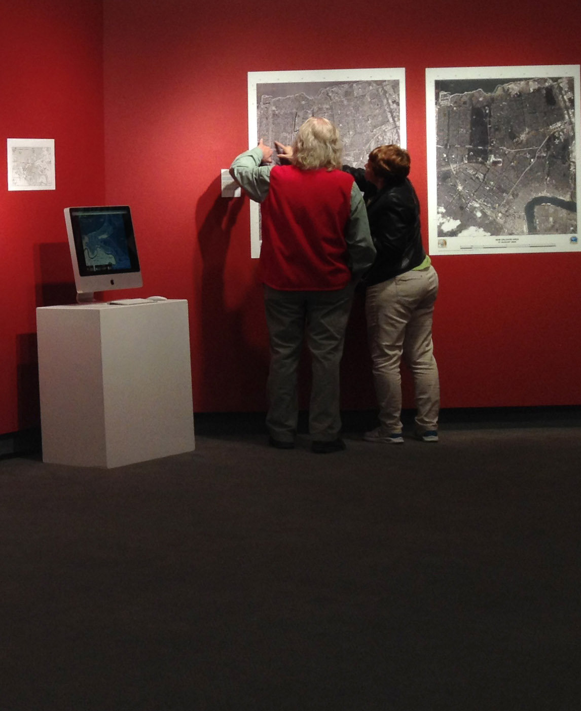 People walking around and looking at a gallery exhibit.