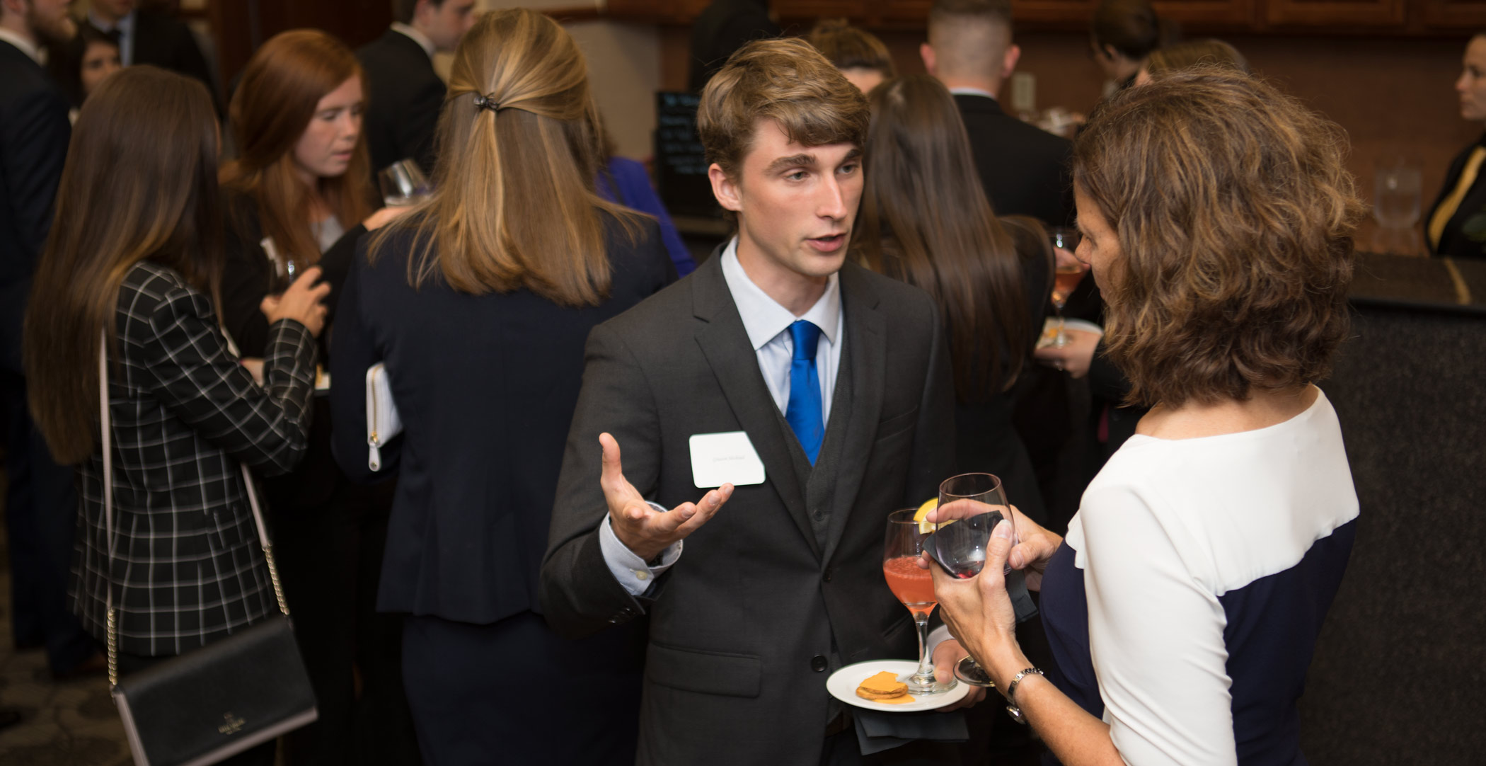 Patty Navin speaks with Graeson Michaud. Ohio Northern University Dicke College of Business Administration juniors participated in an etiquette dinner at The Inn at Ohio Northern University.