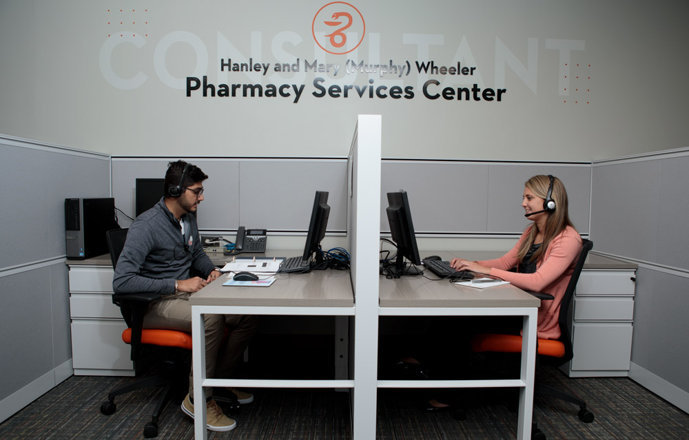 Pharmacy students work at the Pharmacy Services Center
