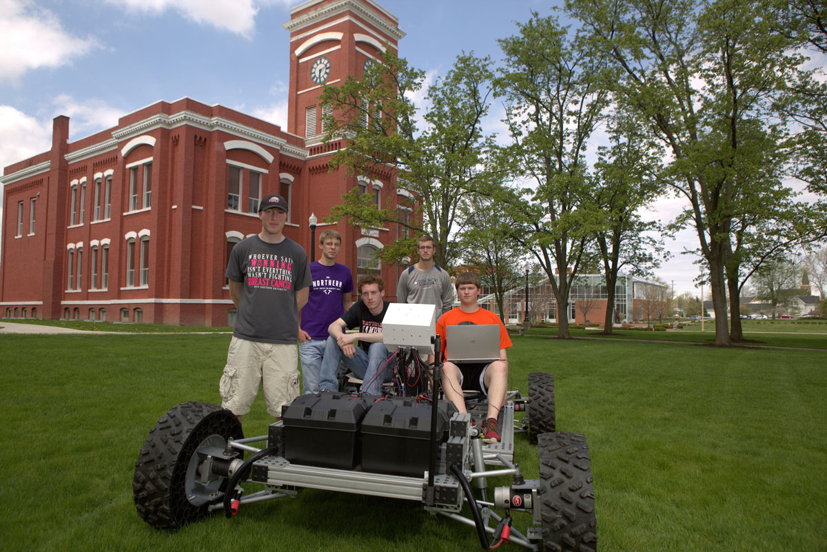 Students with the lunar rover vehicle