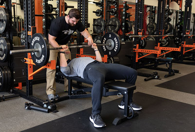 Johnny Rupp trains a student during a workout