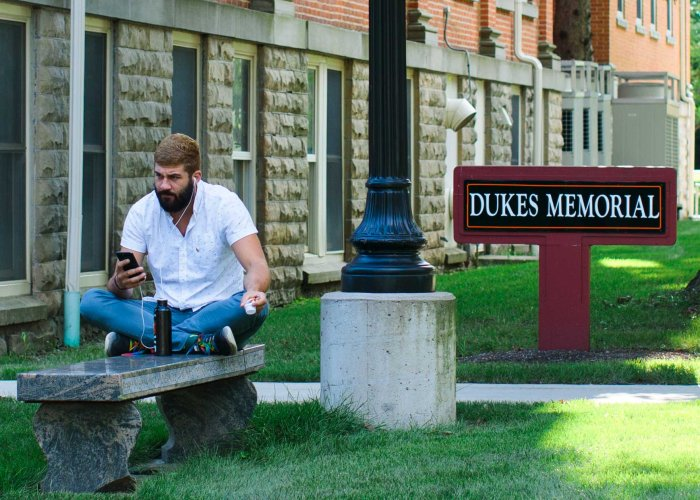 student on phone at dukes