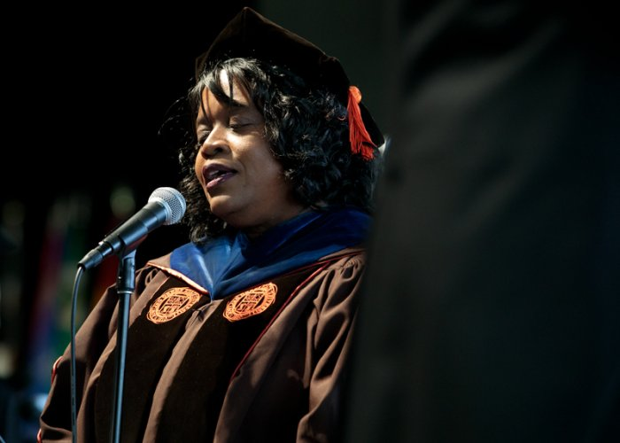 Adriane Thompson-Bradshaw singing at graduation