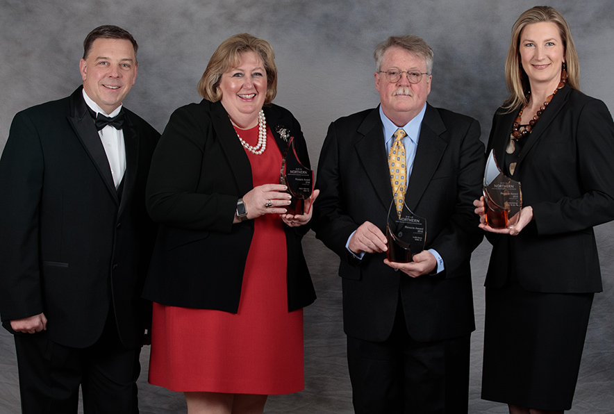From left are John C. Navin, dean of ONU's Dicke College of Business Administration; and Pinnacle Award recipients Deann Fishpaw Newman; Jerry Davis, accepting on behalf of his late wife, Judy (Monastra) Davis; and Anmarie (Gladieux) Kolinski.
